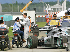 Michael Schumacher is forced out of the Malaysian Grand Prix