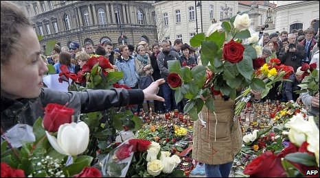 People lay flowers in Warsaw
