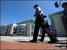Police walk past the Washington Convention Center, Washington DC, on 10 April ahead of the Nuclear Security Summit