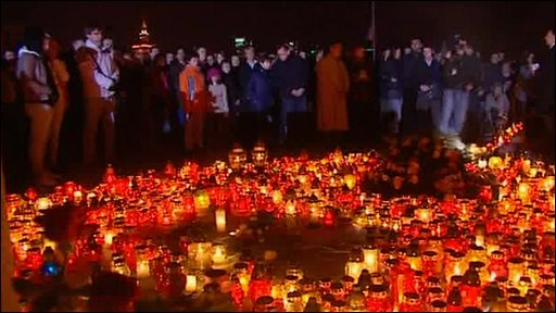 Candles are lit outside the presidential palace in Warsaw