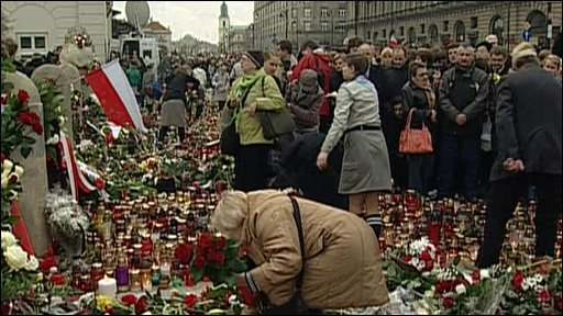 Floral tributes are laid by the public to victims of Poland's plane crash