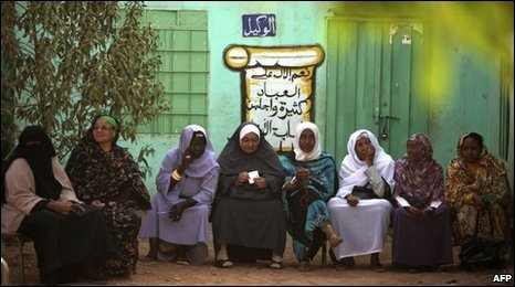 Sudanese women wait to vote outside a school on Khartoum