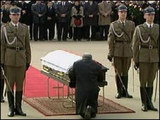 Jaroslaw Kaczynski prays over the coffin of his twin brother, Lech, at Warsaw airport, 11 April 2010