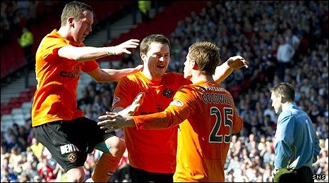 Danny Swanson and Jon Daly congratulate David Goodwillie