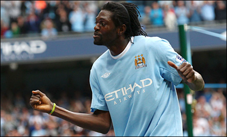 Emmanuel Adebayor celebrates after scoring Manchester City's fifth goal