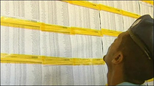 A man looks for his name on the Sudanese electoral roll