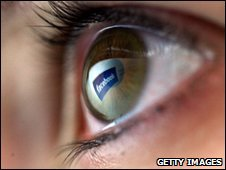 Eye with Facebook sign reflected in it