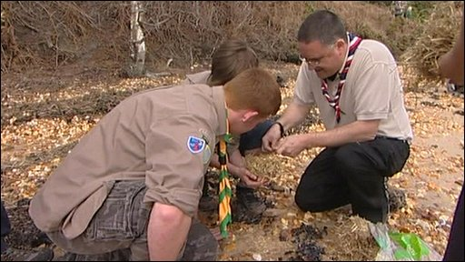 Scouts learning how to light a campfire