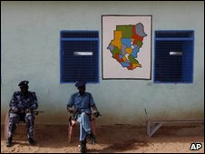 Soldiers sit outside polling station in Sudan