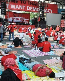 Red-shirt protesters rest at one of their camps in Bangkok, 12 April