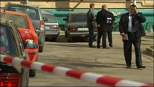 Police tape and investigators at the scene