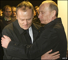 Russian Prime Minister Vladimir Putin (right) hugs his Polish counterpart Donald Tusk at crash site, 10 Apr 10