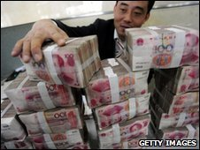 Man holding lots of yuan