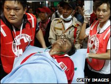 Hospital workers treat an injured protesters in Bangkok, Thailand (10 April 2010)