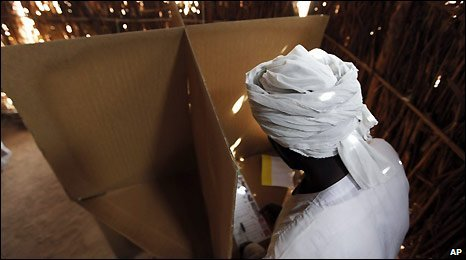 A man votes in the Darfur town of el Fasher, Sudan, Sunday