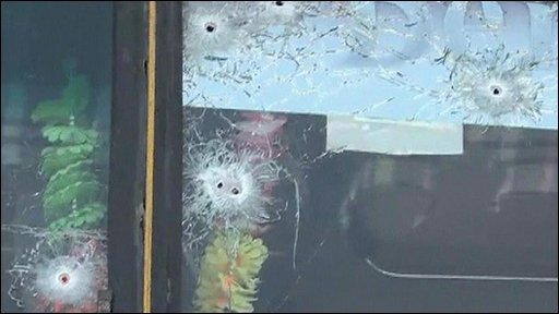 Bus window with bullet holes
