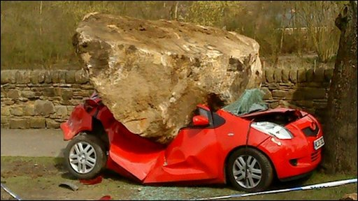 Joan Hall's car, and the boulder