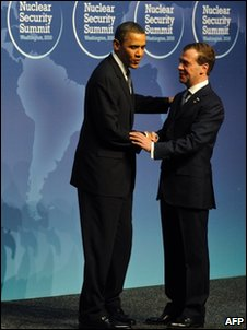 Barack Obama (L) greets Dmitry Medvedev at the summit, 12 April