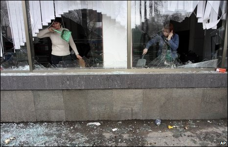 Workers clean up a looted shop in Bishkek on 8 April 2010
