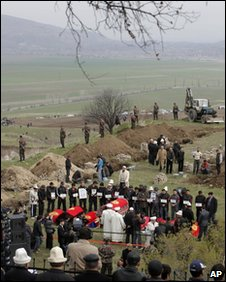 A mass funeral is held on the outskirts of Bishkek on 10 April 2010
