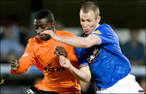 Dundee United midfielder Prince Buaben and Rangers striker Kenny Miller