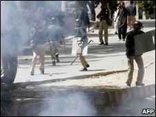 Pakistani policemen clash with protesters in Abbottabad