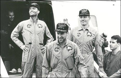 Astronauts aboard recovery vessel