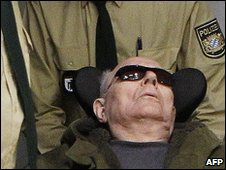 Accused Nazi death camp guard John Demjanjuk arrives in the courtroom in Munich on March 23, 2010