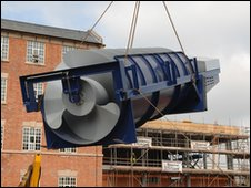 The giant Archimedes Screw is winched into place at the JCB Academy