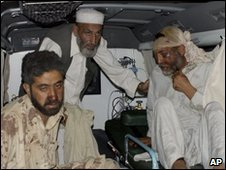People injured in air strike in Pakistan's Khyber region arrive at hospital in Peshawar - 10 April 2010 