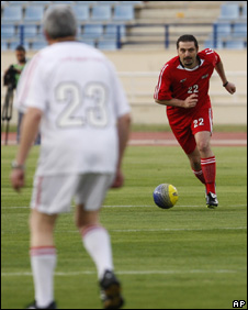 Saad Hariri (right) runs at a member of the opposition