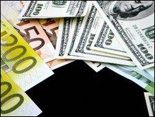 dollar bills and euro notes