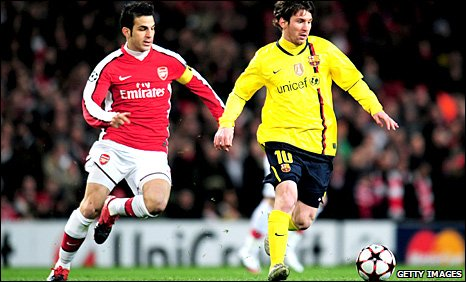 Cesc Fabregas attempts to tackle Lionel Messi