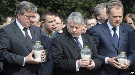 Polish Parliament Speaker Bronislaw Komorowski, left, Senate Speaker Bogdan Borusiewicz, centre, and Prime Minister Donald Tusk