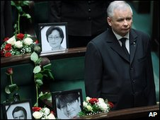 Jaroslaw Kaczynski stands next to the empty seats of parliamentarians killed in the plane crsh