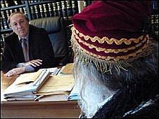 Minas Karaztoglou (right) and his lawyer