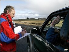 An emergency worker records a driver's details, after hundreds of residents were forced to leave heir homes around 100 km (62 miles) southeast of Reykjavik, April 14, 2010.