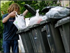 Man emptying waste into wheelie bin