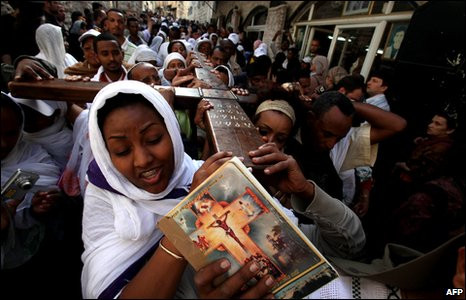 Ethiopian Christian Orthodox worshippers walk along the Via Dolorosa during the Good Friday procession in Jerusalem's old city