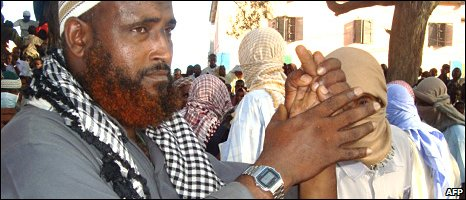 Mohamed Omar Ismail's hand is shown to the crowds before being chopped off
