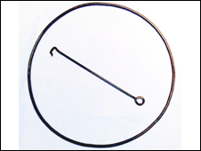 A Victorian hoop and hook toy