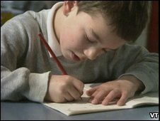 A young boy studying