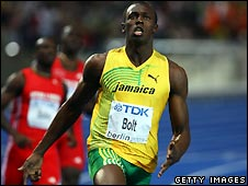 Usain Bolt crossing the winning line