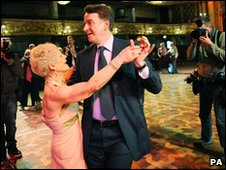 Business Secretary Lord Mandelson dances with Hannah Mackenzie in the Tower Ballroom