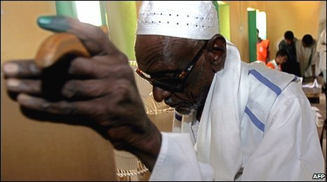 A man votes in al-Kamlin, 150 kms south of the capital Khartoum, on Thursday
