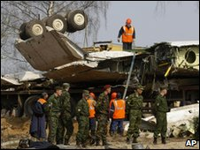 The wreckage of the jet is loaded on to a transporter in Smolensk, 14 April