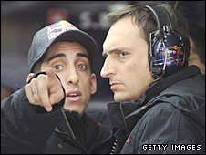 Sebastien Buemi exchanges angry words with a team official