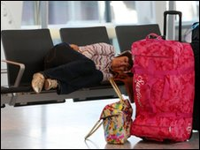 Passenger asleep at Heathrow Airport