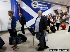 Passengers arrive off a flight from the from the Dominican Republic