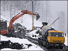 Digger on mountainside near Sochi